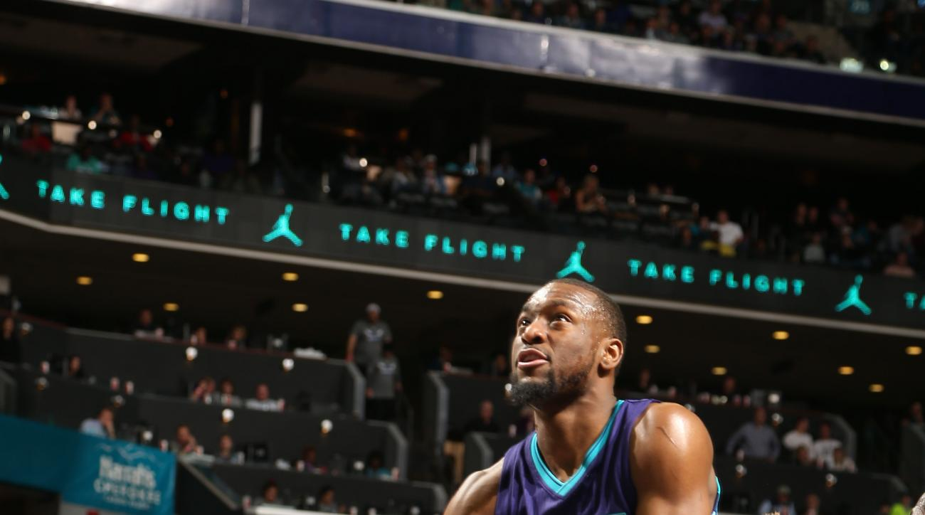 CHARLOTTE, NC  - APRIL 8: Kemba Walker #15 of the Charlotte Hornets goes for the lay up against the Brooklyn Nets during the game on April 8, 2016 at Time Warner Cable Arena in Charlotte, North Carolina. (Photo by Kent Smith/NBAE via Getty Images)