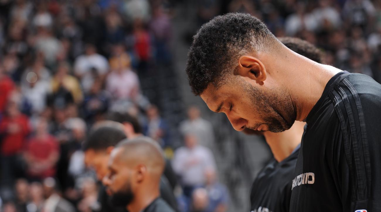 DENVER, CO - APRIL 8:  Tim Duncan #21 of the San Antonio Spurs stands for the national anthem before the game against the Denver Nuggets on April 8, 2016 at the Pepsi Center in Denver, Colorado. (Photo by Garrett Ellwood/NBAE via Getty Images)