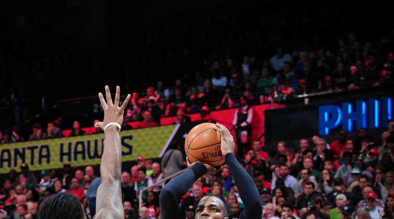 ATLANTA, GA - APRIL 9:  Paul Millsap #4 of the Atlanta Hawks shoots against Jae Crowder #99 of the Boston Celtics on April 9, 2016 at Philips Arena in Atlanta, Georgia.  (Photo by Scott Cunningham/NBAE via Getty Images)