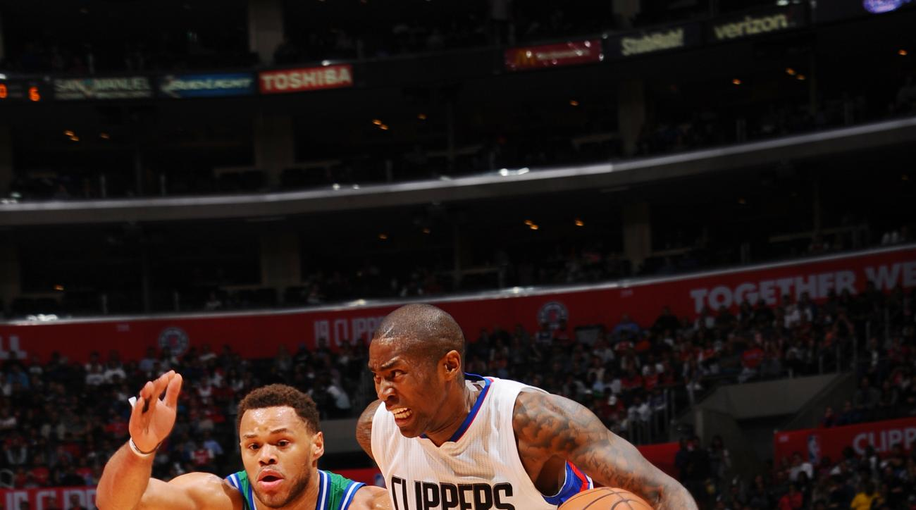 LOS ANGELES, CA  - APRIL 10: Jamal Crawford #11 of the Los Angeles Clippers drives to the basket against the Dallas Mavericks  during the game on April 10, 2016 at STAPLES Center in Los Angeles, California. (Photo by Juan Ocampo/NBAE via Getty Images)