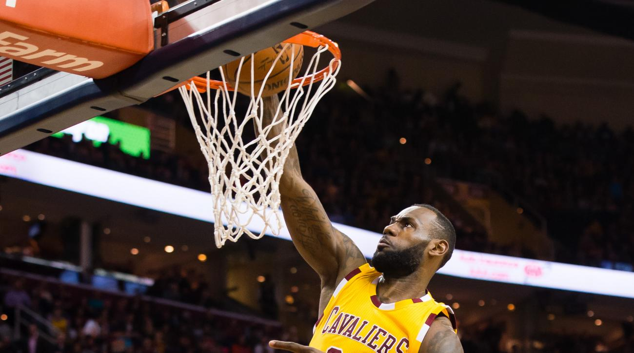 CLEVELAND, OH - APRIL 11: LeBron James #23 of the Cleveland Cavaliers dunks during the first half against the Atlanta Hawks at Quicken Loans Arena on April 11, 2016 in Cleveland, Ohio. (Photo by Jason Miller/Getty Images)