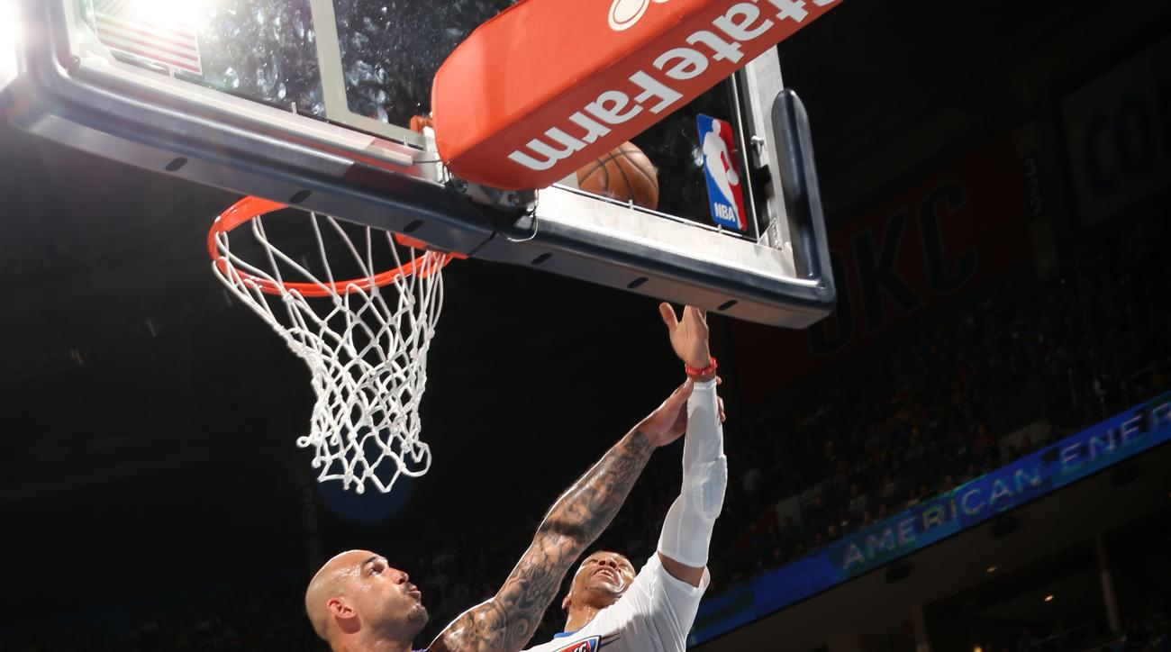 OKLAHOMA CITY, OK- APRIL 11:  Russell Westbrook #0 of the Oklahoma City Thunder shoots a lay up against Robert Sacre #50 of the Los Angeles Lakers on April 11, 2016 at Chesapeake Energy Arena in Oklahoma City, Oklahoma. (Photo by Layne Murdoch/NBAE via Ge