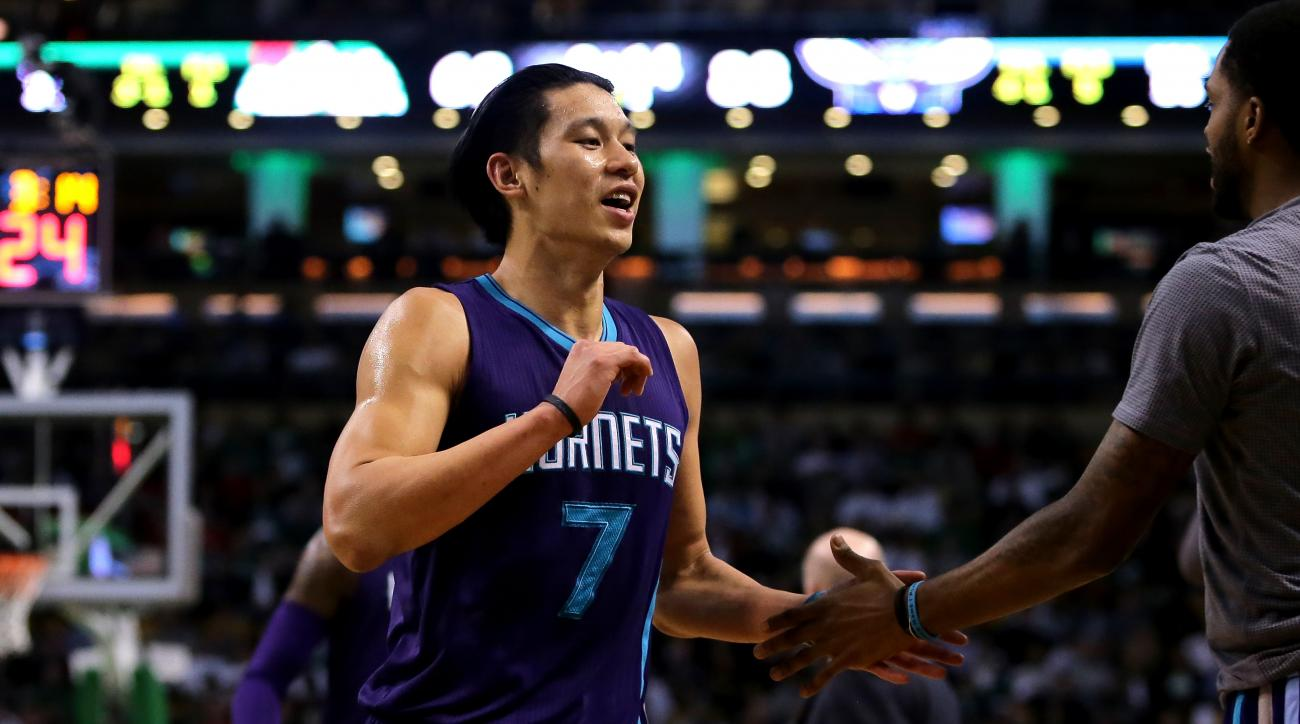 BOSTON, MASSACHUSETTS - APRIL 11: Jeremy Lin #7 of the Charlotte Hornets celebrates after a play in the third quarter against the Boston Celtics at TD Garden on April 11, 2016 in Boston, Massachusetts. (Photo by Mike Lawrie/Getty Images)