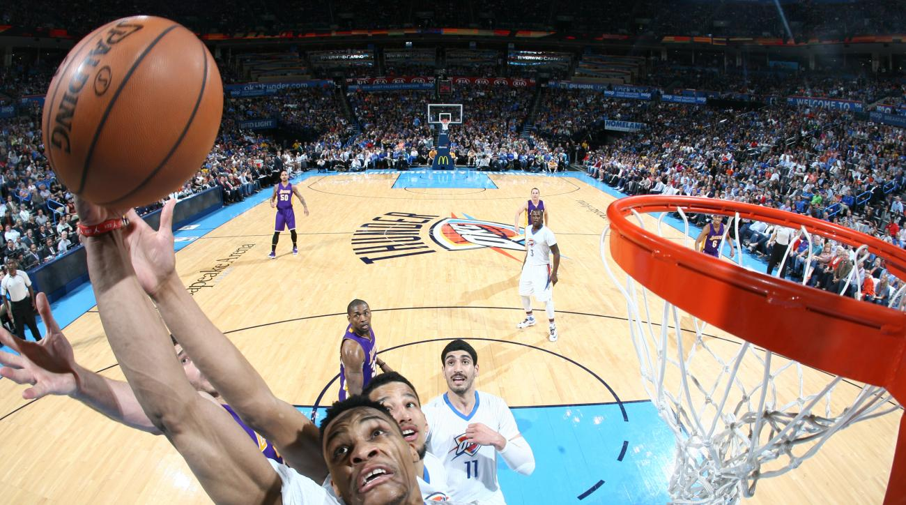 OKLAHOMA CITY, OK- APRIL 11:  Russell Westbrook #0 of the Oklahoma City Thunder grabs the rebound against the Los Angeles Lakers on April 11, 2016 at Chesapeake Energy Arena in Oklahoma City, Oklahoma. (Photo by Layne Murdoch/NBAE via Getty Images)