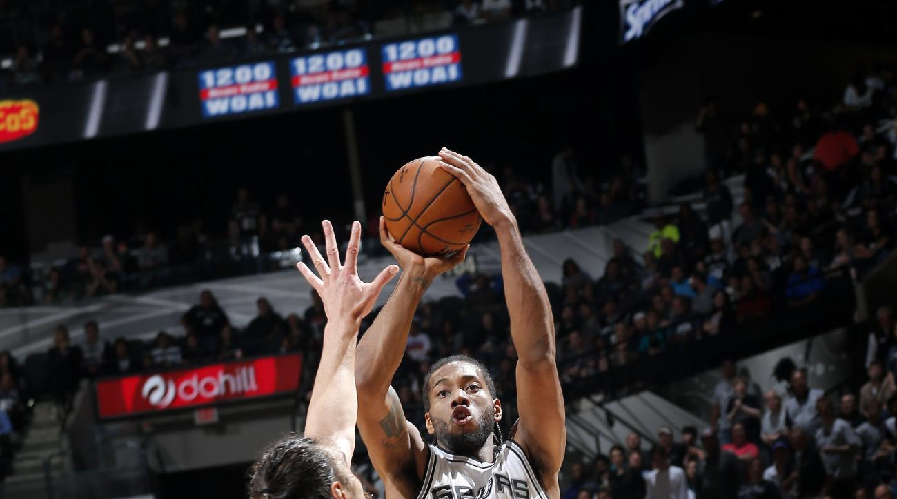 SAN ANTONIO, TX - APRIL 12: Kawhi Leonard #2 of the San Antonio Spurs shoots the ball during the game against the Oklahoma City Thunder on April 12, 2016 at the AT&T Center in San Antonio, Texas.