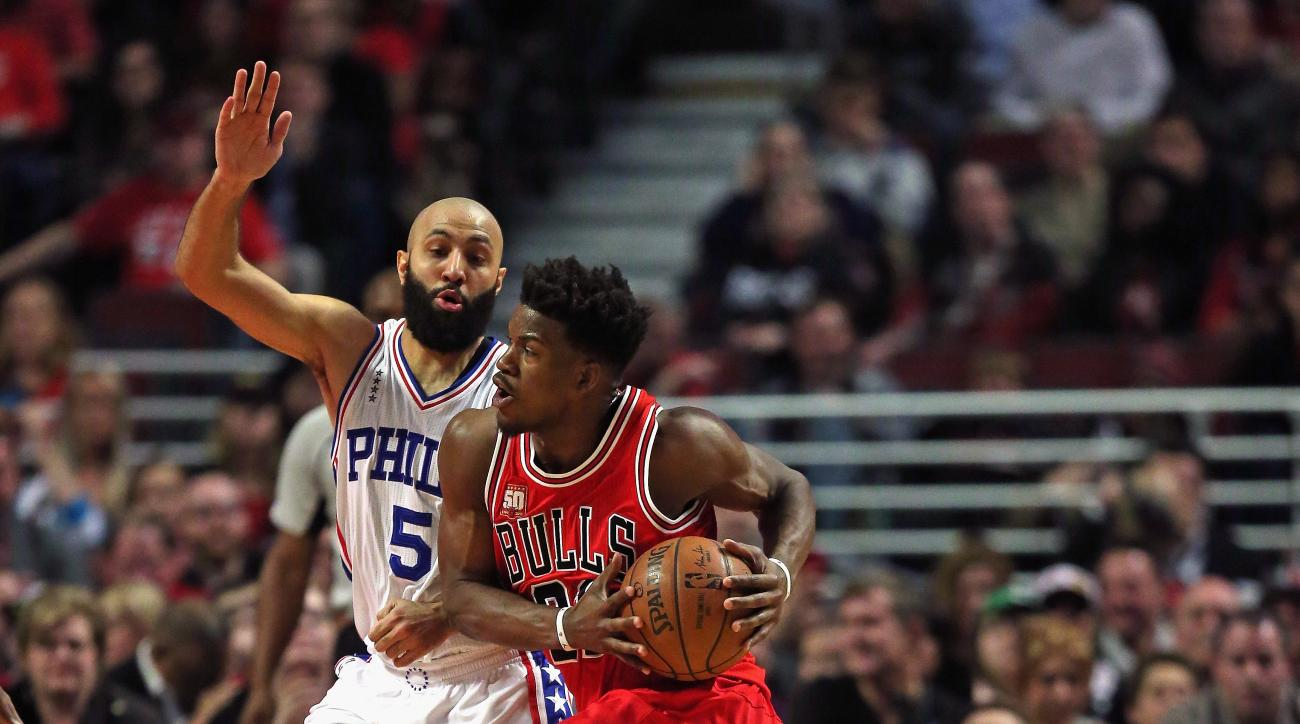 CHICAGO, IL - APRIL 13: Jimmy Butler #21 of the Chicago Bulls drives against Kendall Marshall #5 of the Philadelphia 76ers at the United Center on April 13, 2016 in Chicago, Illinois.  (Photo by Jonathan Daniel/Getty Images)