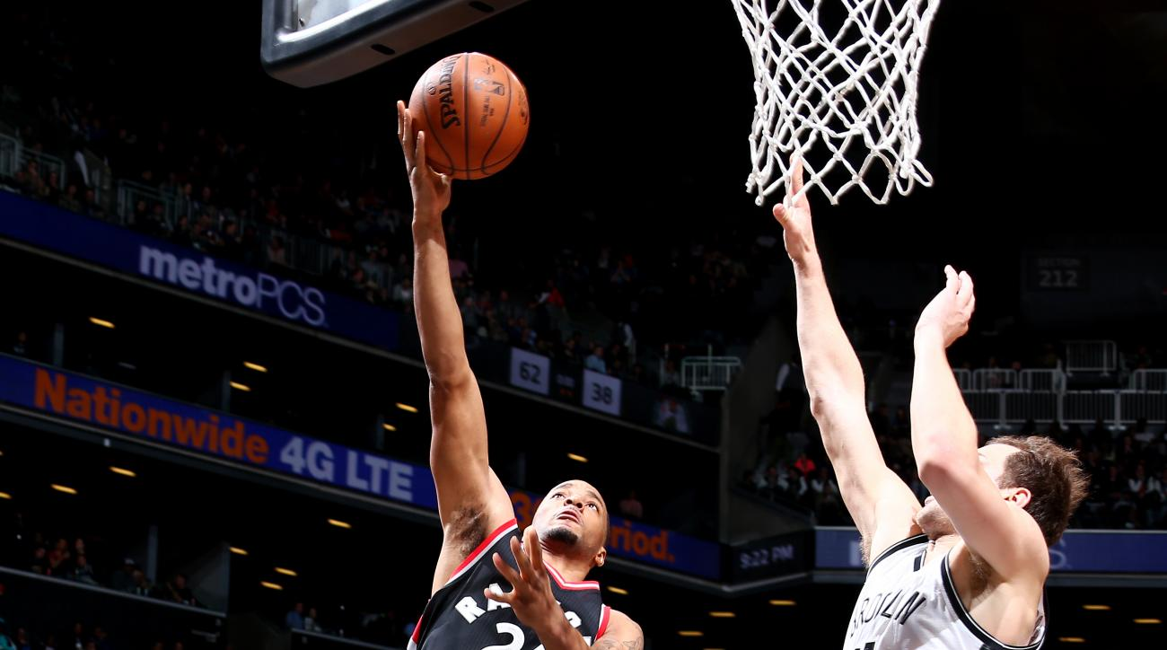 BROOKLYN, NY - APRIL 13:  Norman Powell #24 of the Toronto Raptors drives to the basket against the Brooklyn Nets on April 13, 2016 at Barclays Center in Brooklyn, New York. (Photo by Nathaniel S. Butler/NBAE via Getty Images)
