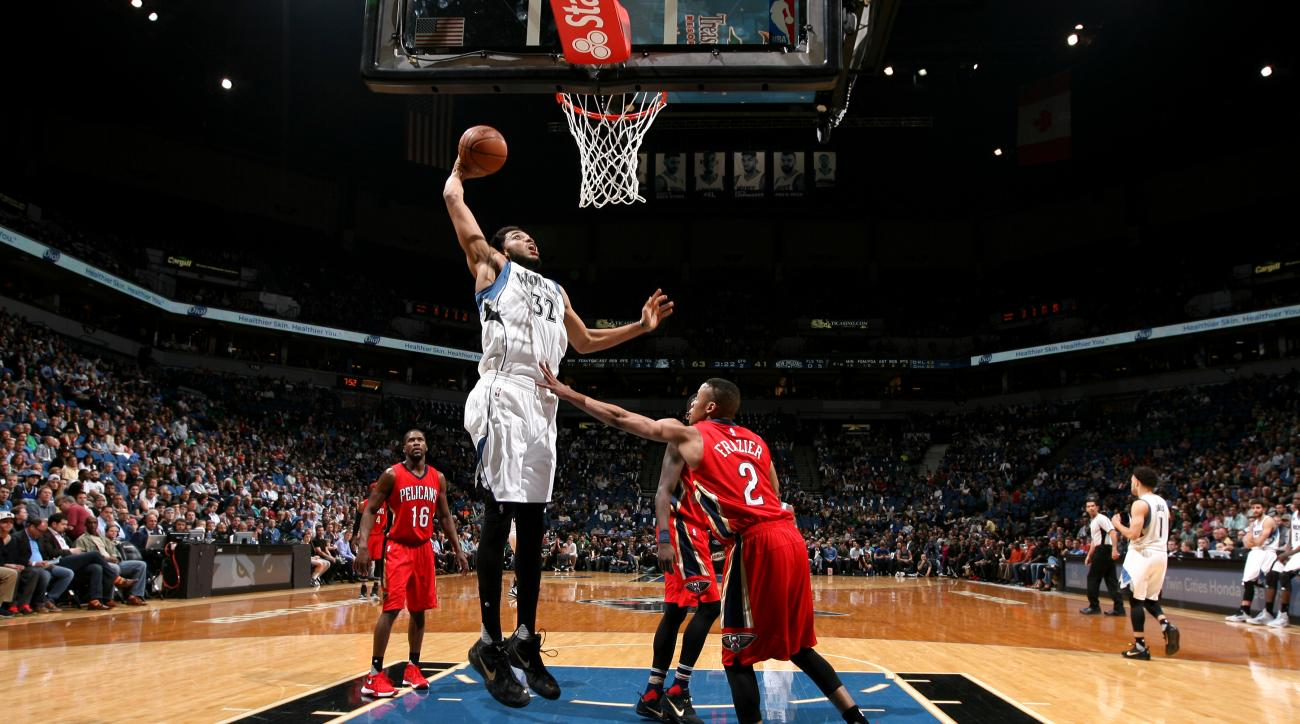 MINNEAPOLIS, MN -  APRIL 13: Karl-Anthony Towns #32 of the Minnesota Timberwolves goes for the lay up while wearing commemorative Mamba Day sneakers during the game against the New Orleans Pelicans on April 13, 2016 at Target Center in Minneapolis, Minnes