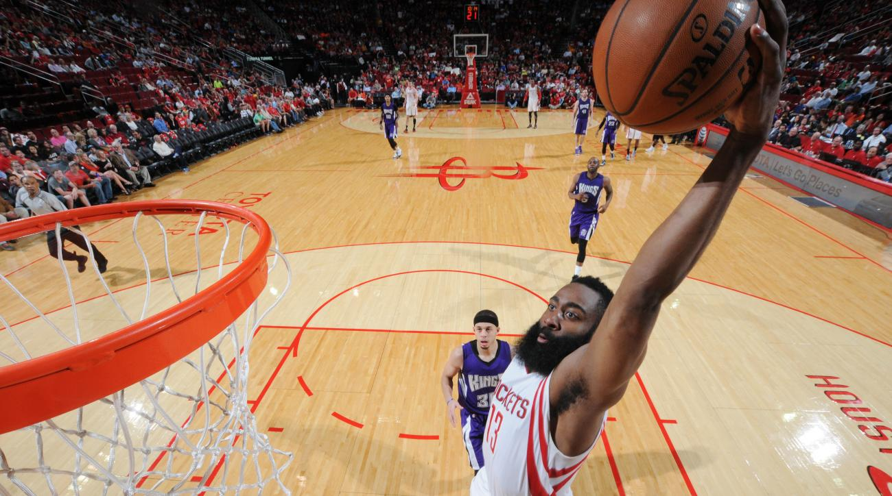 HOUSTON, TX - APRIL 13: James Harden #13 of the Houston Rockets dunks against the Sacramento Kings on April 13, 2016 at the Toyota Center in Houston, Texas. (Photo by Bill Baptist/NBAE via Getty Images)
