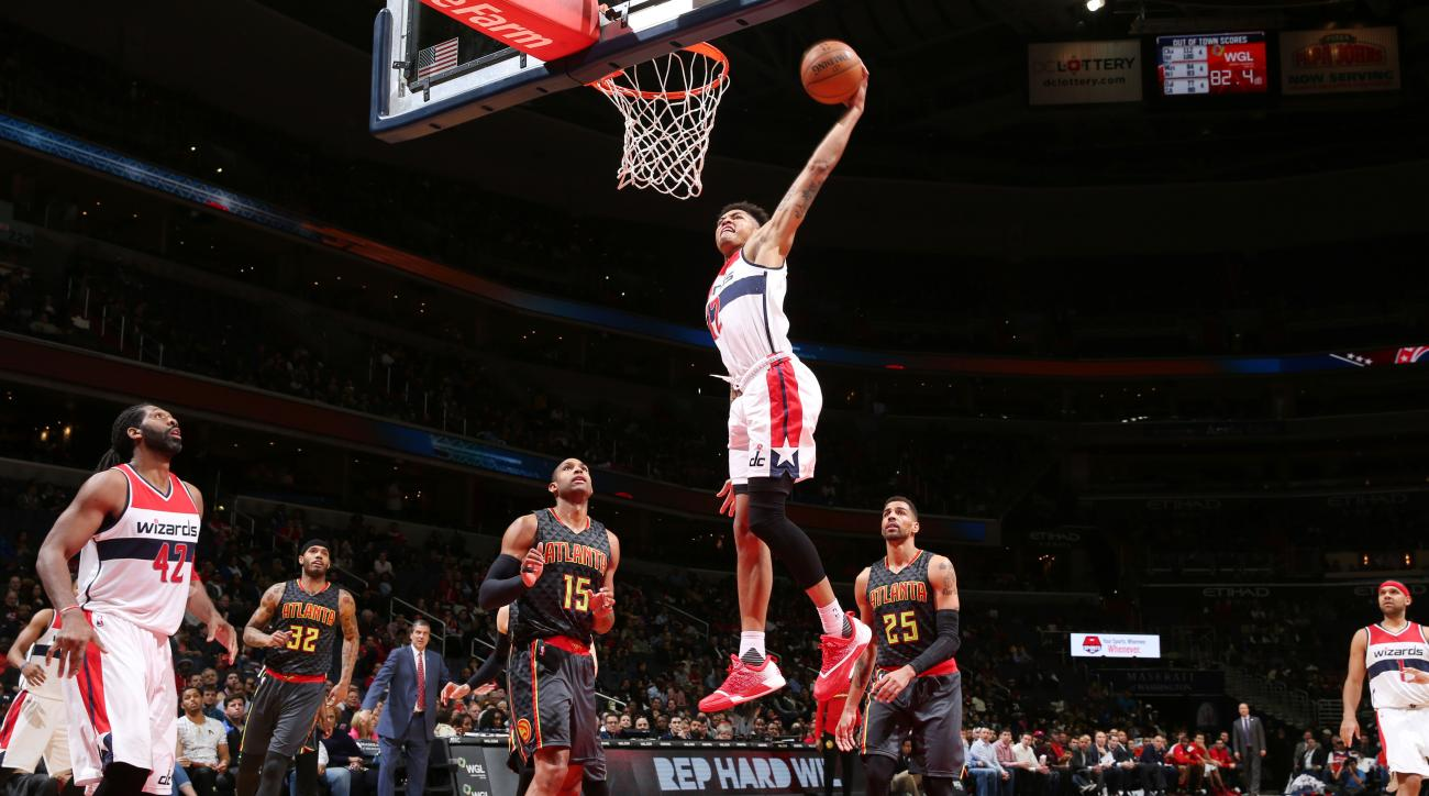 WASHINGTON, DC  - APRIL 13: Kelly Oubre Jr. #12 of the Washington Wizards goes for the dunk against the Atlanta Hawks during the game on April 13, 2016 at Verizon Center in Washington, District of Columbia. (Photo by Ned Dishman/NBAE via Getty Images)