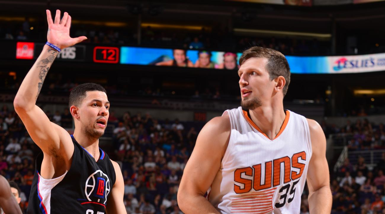 PHOENIX, AZ - APRIL 13:  Mirza Teletovic #35 of the Phoenix Suns handles the ball against Austin Rivers #25 of the Los Angeles Clippers on April 13, 2016 at Talking Stick Resort Arena in Phoenix, Arizona. (Photo by Barry Gossage/NBAE via Getty Images)