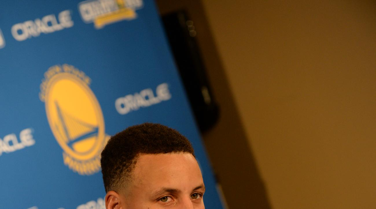 OAKLAND, CA - APRIL 13:  Stephen Curry #30 of the Golden State Warriors speaks at a post game press conference after the game against the Memphis Grizzlies on April 13, 2016 at ORACLE Arena in Oakland, California. (Photo by Noah Graham/NBAE via Getty Imag