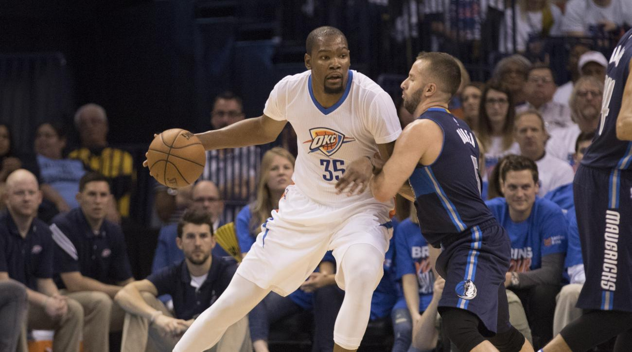OKLAHOMA CITY, OK - APRIL 16: Kevin Durant #35 of the Oklahoma City Thunder tries to drive around J.J. Barea #5 of the Dallas Mavericks during the first half of Game One of the Western Conference Quarterfinals during the 2016 NBA Playoffs at the Chesapeak