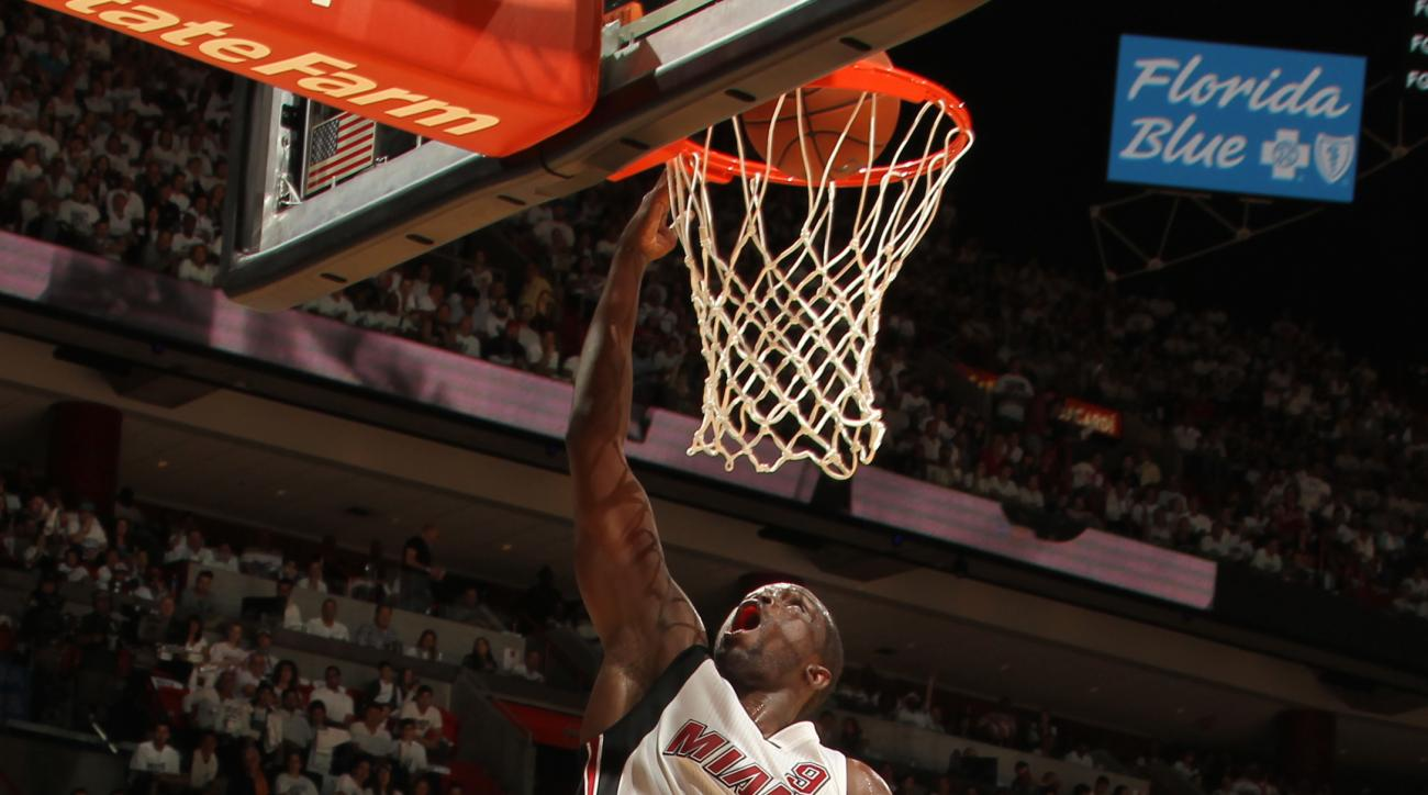 MIAMI, FL  - APRIL 17: Luol Deng #9 of the Miami Heat goes for the dunk against the Charlotte Hornets during Game One of the Eastern Conference Quarterfinals of the 2016 NBA Playoffs on April 17, 2016 at American Airlines Arena in Miami, Florida. (Photo b