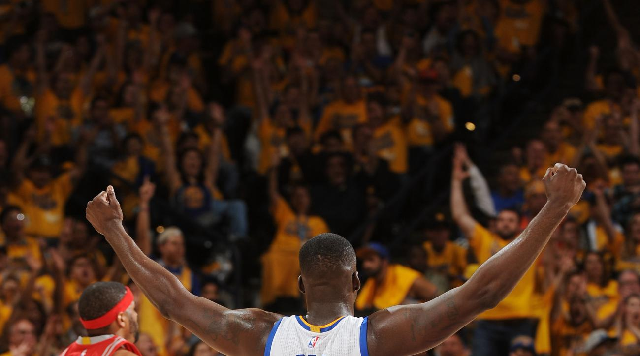 OAKLAND, CA - APRIL 18:  Draymond Green #23 of the Golden State Warriors celebrates during the game against the Houston Rockets in Game Two of the Western Conference Quarterfinals during the 2016 NBA Playoffs on April 18, 2016 at ORACLE Arena in Oakland,