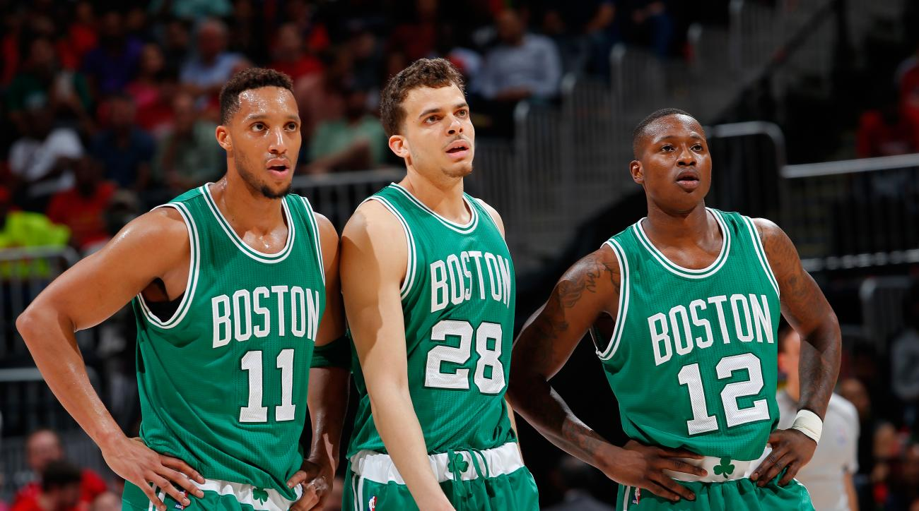 ATLANTA, GA - APRIL 19:  Evan Turner #11, R.J. Hunter #28 and Terry Rozier #12 of the Boston Celtics watch an Atlanta Hawks free throw after Rozier was called for a technical foul in Game Two of the Eastern Conference Quarterfinals during the 2016 NBA Pla
