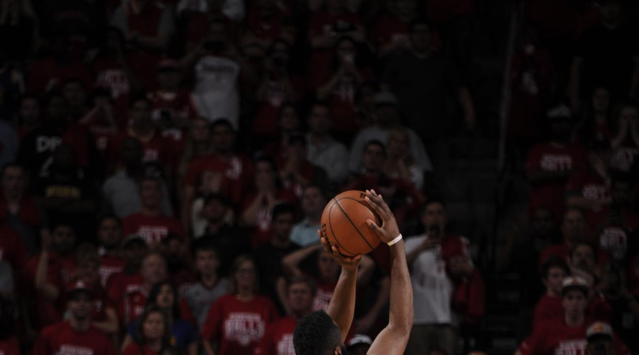 HOUSTON, TX - APRIL 21:  James Harden #13 of the Houston Rockets scores the winning basket against the Golden State Warriors in Game Three of the Western Conference Quarterfinals during the 2016 NBA Playoffs on April 21, 2016 at the Toyota Center in Houst