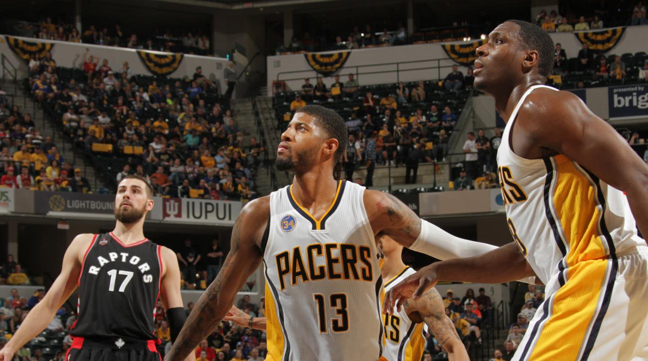 INDIANAPOLIS, IN - APRIL 23: Paul George #13 of the Indiana Pacers defends the basket against the Toronto Raptors during Game Three of the Eastern Conference Quarterfinals during the 2016 NBA Playoffs on April 23, 2016 at Bankers Life Fieldhouse in Indian