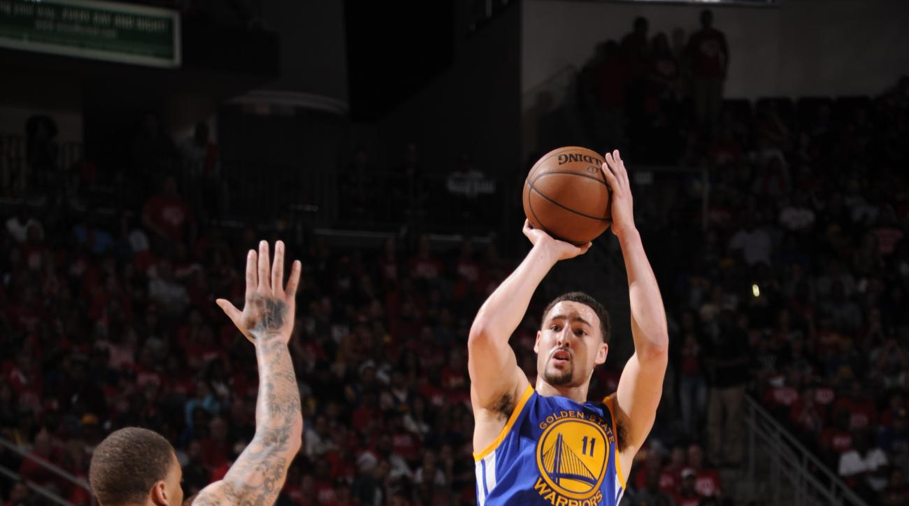 HOUSTON, TX - APRIL 24:  Klay Thompson #11 of the Golden State Warriors shoots the ball against the Houston Rockets in Game Four of the Western Conference Quarterfinals during the 2016 NBA Playoffs on April 24, 2016 at the Toyota Center in Houston, Texas.