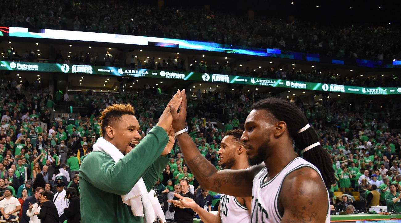BOSTON, MA - APRIL 24:  Jared Sullinger #7 of the Boston Celtics shakes hands with Jae Crowder #99 of the Boston Celtics after the game against the Atlanta Hawks in Game Four of the Eastern Conference Quarterfinals during the 2016 NBA Playoffs on April 24
