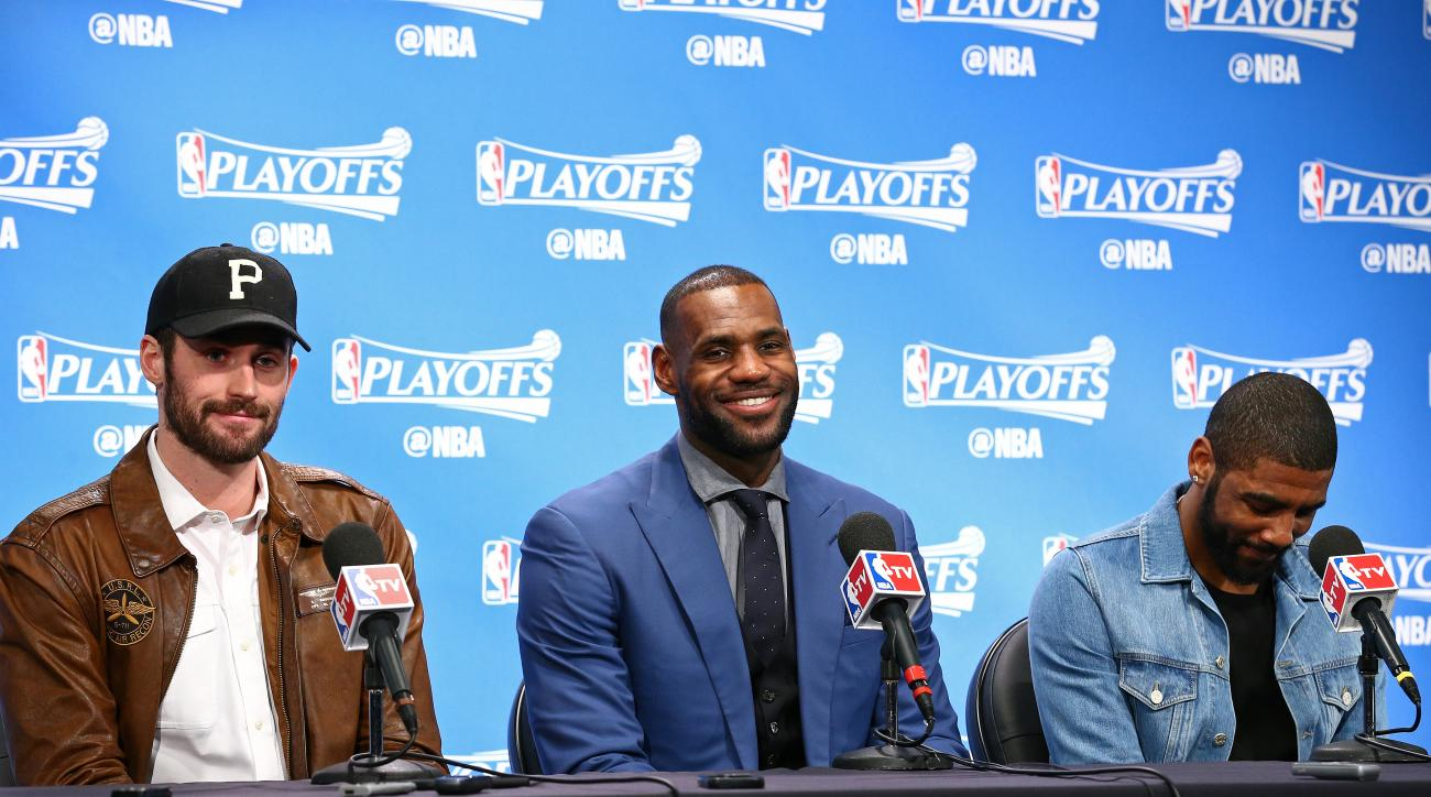 AUBURN HILLS, MI - APRIL 24:  Kevin Love #0, LeBron James #23 and Kyrie Irving #2 of the Cleveland Cavaliers speak at a press conference after Game Four of the Eastern Conference Quarterfinals against the Detroit Pistons during the 2016 NBA Playoffs on  A