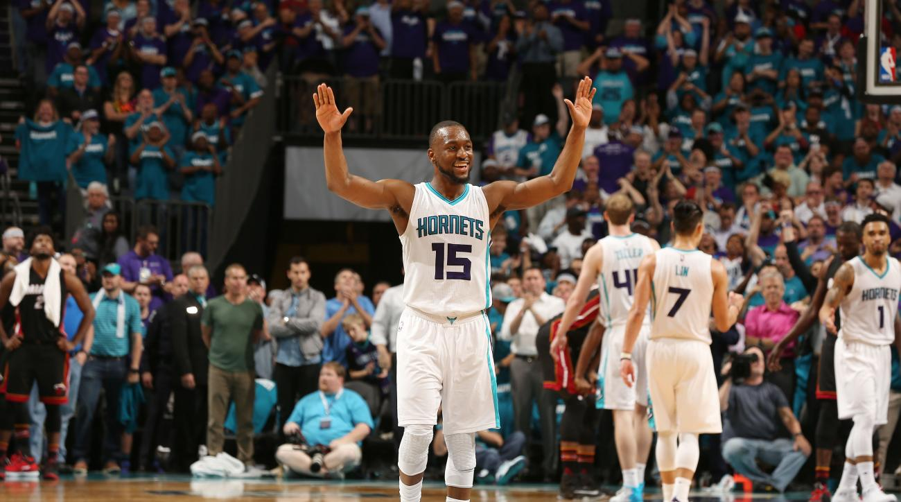 CHARLOTTE, NC - APRIL 25: Kemba Walker #15 of the Charlotte Hornets reacts after a play against the Miami Heat during Game Four of the Eastern Conference Quarterfinals during the 2016 NBA Playoffs on April 25, 2016 at Time Warner Cable Arena in Charlotte,