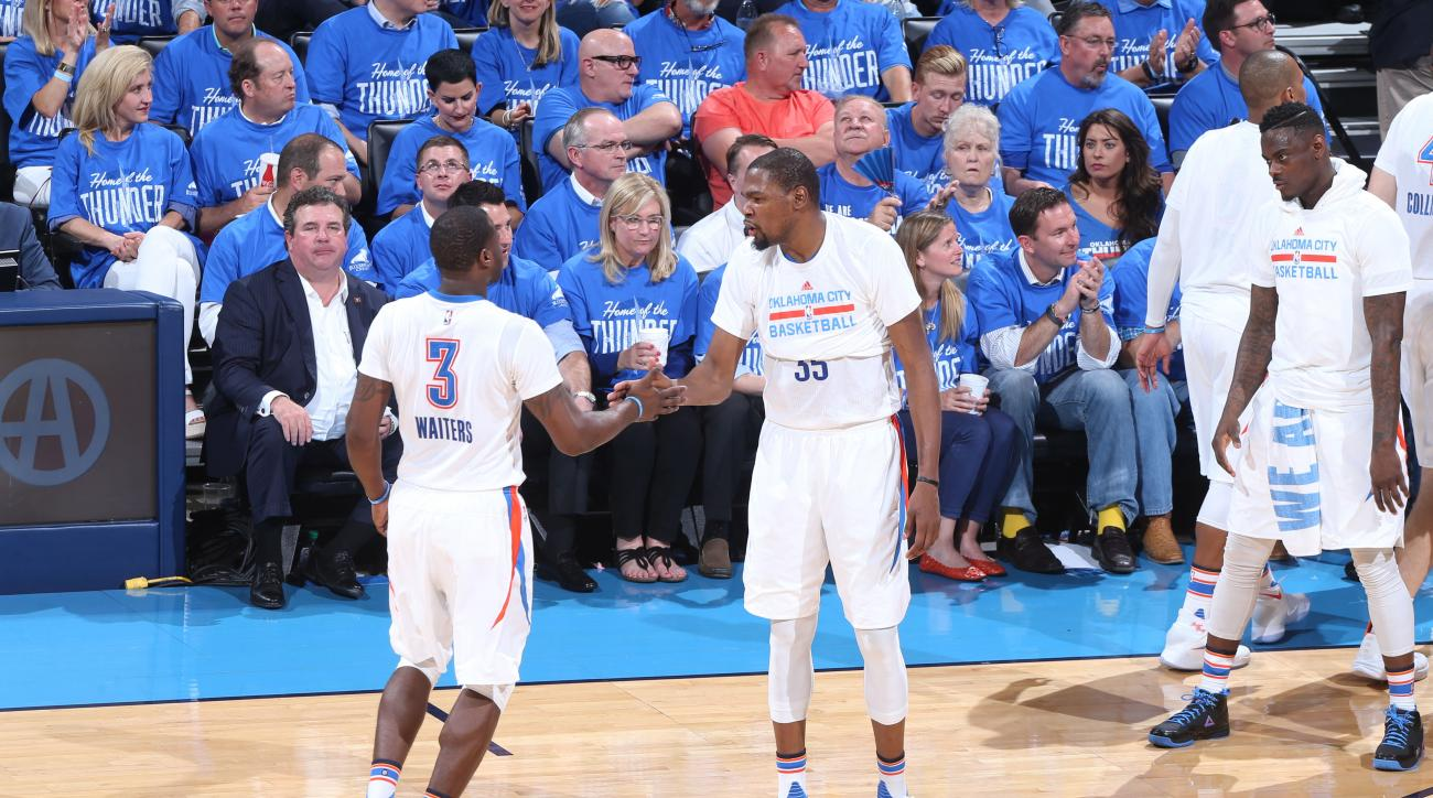 OKLAHOMA CITY, OK - APRIL 25: Dion Waiters #3 high fives teammate Kevin Durant #35 of the Oklahoma City Thunderduring Game Five of the Western Conference Quarterfinals during the 2016 NBA Playoffs against the Dallas Mavericks on April 25, 2016 at Chesapea