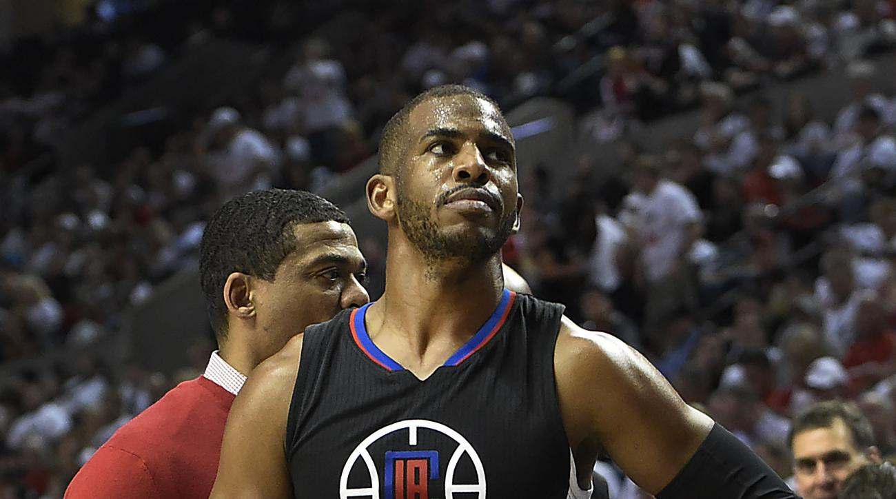 PORTLAND, OR - APRIL 25: Chris Paul #3 of the Los Angeles Clippers walks off the court after he injured his hand in the third quarter of Game Four of the Western Conference Quarterfinals against the Portland Trail Blazers during the 2016 NBA Playoffs at t