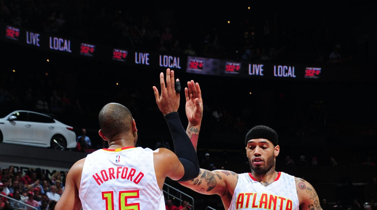 ATLANTA, GA - APRIL 26:  Al Horford #15 of the Atlanta Hawks high fives Mike Scott #32 of the Atlanta Hawks against the Boston Celtics in Game Five of the Eastern Conference Quarterfinals during the 2016 NBA Playoffs on April 26, 2016 at Philips Arena in