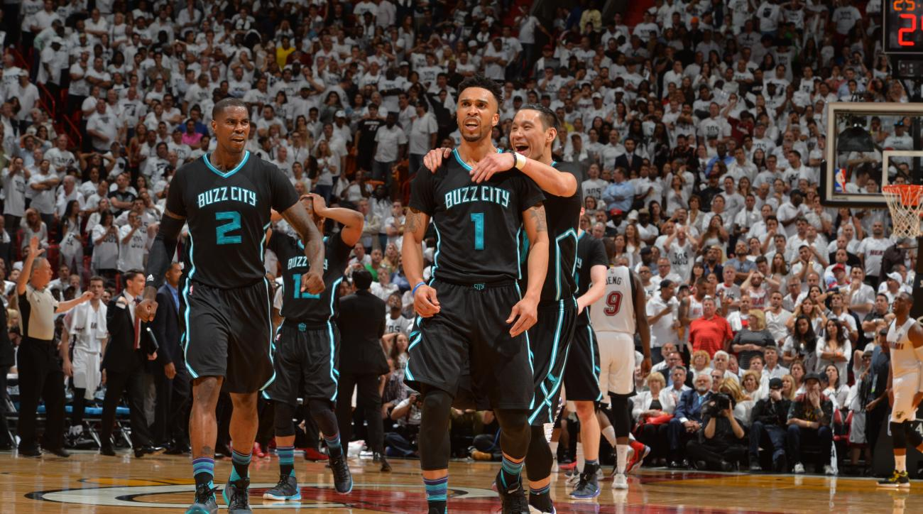 MIAMI,FL - APRIL 27:  Courtney Lee #1 of the Charlotte Hornets hits the game winner against the Miami Heat and is congratulated by his teammates during the Eastern Conference playoffs First Round Game Five on April 27, 2016 at the American Airlines Arena