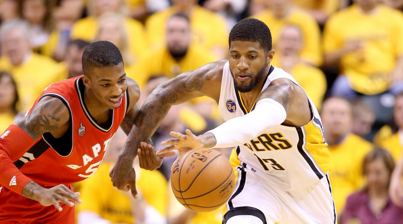 INDIANAPOLIS, IN - APRIL 29:  Paul George #13 of the Indiana Pacers battles for a loose ball with Delon Wright #55 of the Toronto Raptors in game six of the 2016 NBA Playoffs Eastern Conference Quarterfinals on April 29, 2016 in Indianapolis, Indiana.  (P