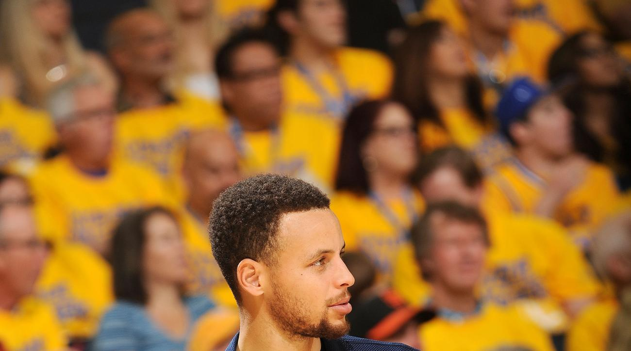 OAKLAND, CA - MAY 1: Stephen Curry #30 of the Golden State Warriors looks on during the game against the Portland Trail Blazers in Game One of the Western Conference Semifinals during the 2016 NBA Playoffs on May 1, 2016 at ORACLE Arena in Oakland, Califo