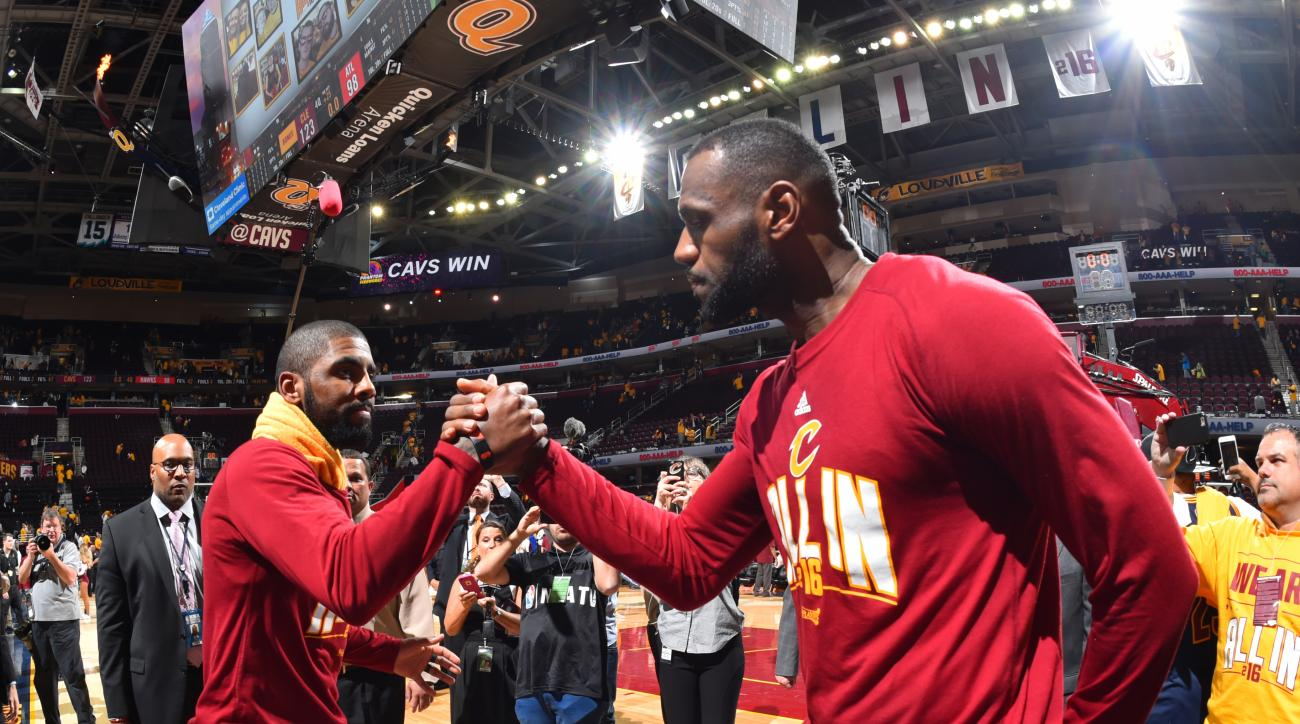 CLEVELAND,OH - MAY 4 :  LeBron James #23 and Kyrie Irving #2 of the Cleveland Cavaliers congratulate each other after the win against the Atlanta Hawks during the Eastern Conference Semifinals Game One on May 4, 2016 at The Quicken Loans Arena in Clevelan