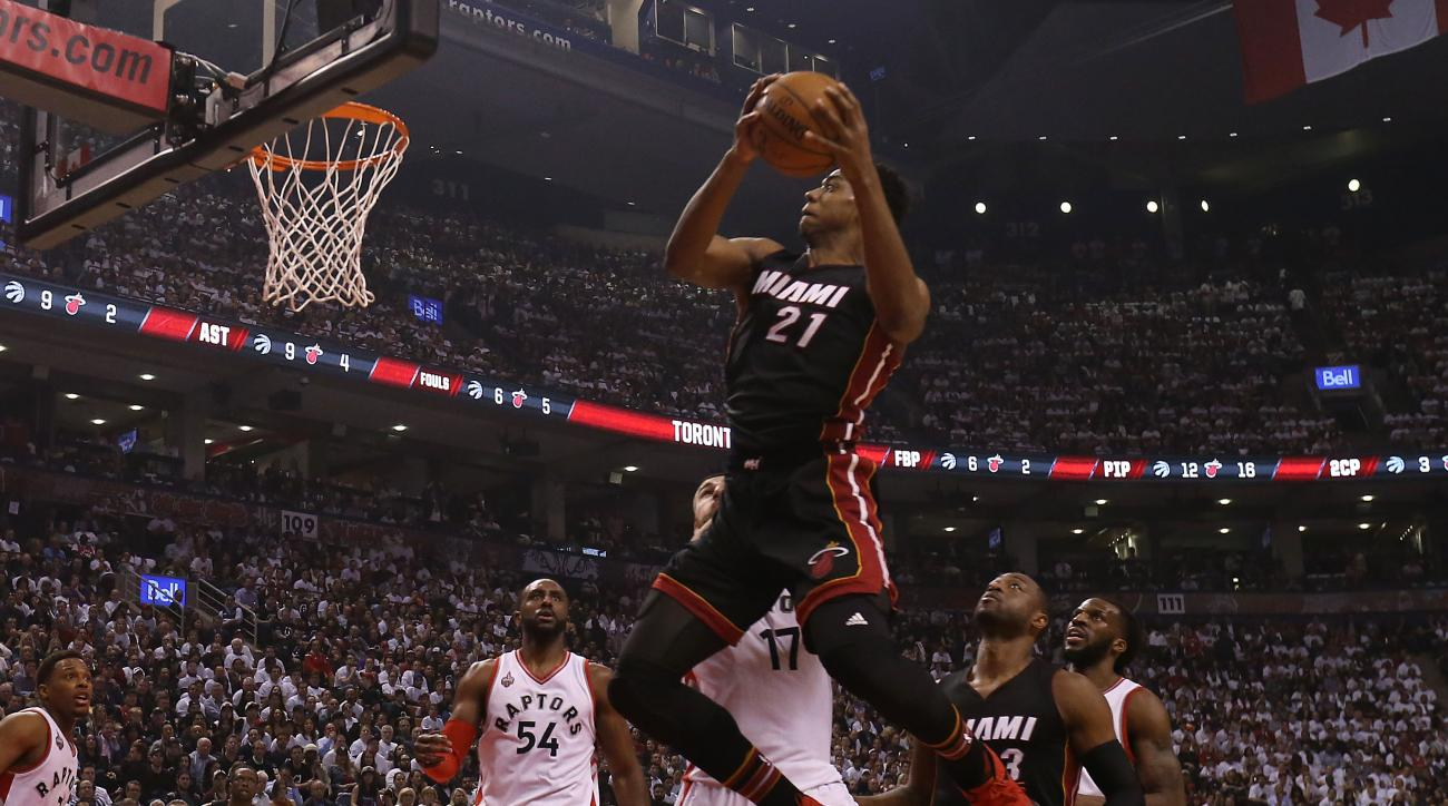 TORONTO, CANADA - MAY 5, 2016:  Hassan Whiteside #21 of the Miami Heat drives to the basket against the Toronto Raptors during Game Two of the Eastern Conference Semi Finals at Air Canada Centre on May 5, 2016 in Toronto, Ontario, Canada. (Photo by Dave S