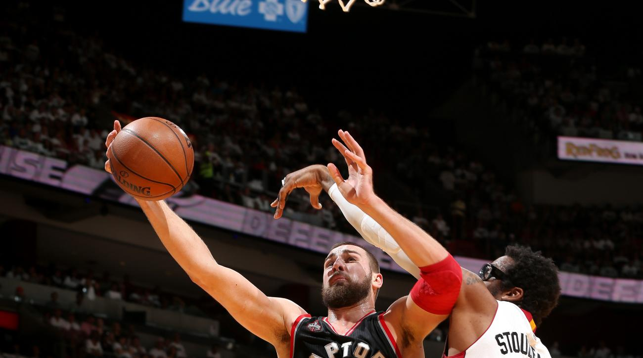 MIAMI, FL - MAY 7: Jonas Valanciunas #17 of the Toronto Raptors goes for the lay up during the game against the Miami Heat in Game Three of the Eastern Conference Semifinals during the 2016 NBA Playoffs on May 7, 2016 at AmericanAirlines Arena in Miami, F