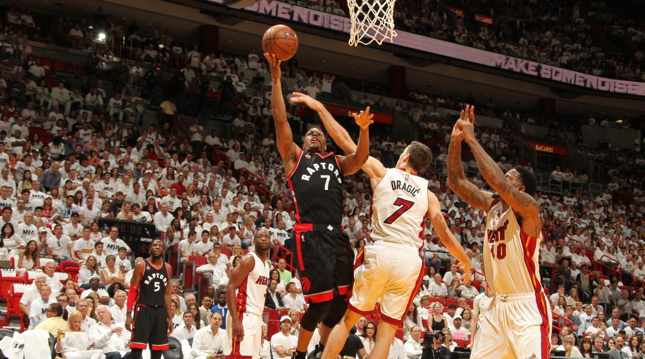 MIAMI, FL - MAY 7: Kyle Lowry #7 of the Toronto Raptors shoots a lay up during the game against the Miami Heat in Game Three of the Eastern Conference Semifinals during the 2016 NBA Playoffs on May 7, 2016 at AmericanAirlines Arena in Miami, Florida. (Pho