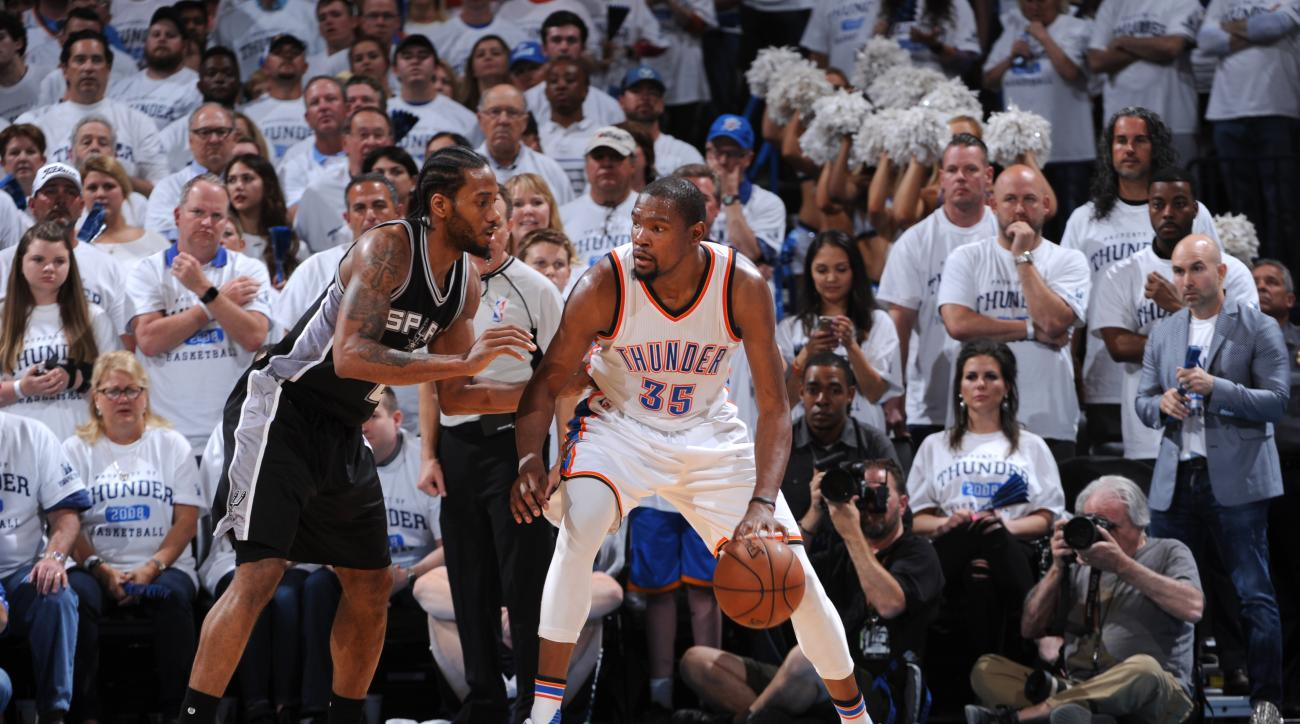 OKLAHOMA CITY, OK - MAY 8:  Kevin Durant #35 of the Oklahoma City Thunder handles the ball against Kawhi Leonard #2 of the San Antonio Spurs in Game Four of the Western Conference Semifinals during the 2016 NBA Playoffs on May 8, 2016 at Chesapeake Energy
