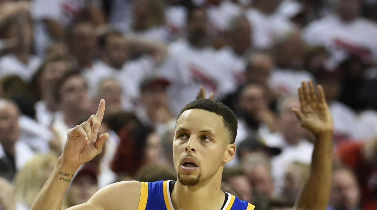 PORTLAND, OR - MAY 9: Stephen Curry #30 of the Golden State Warriors celebrates after hitting a shot during overtime  of Game Four of the Western Conference Semifinals against the Portland Trail Blazers during the 2016 NBA Playoffs at the Moda Center on M