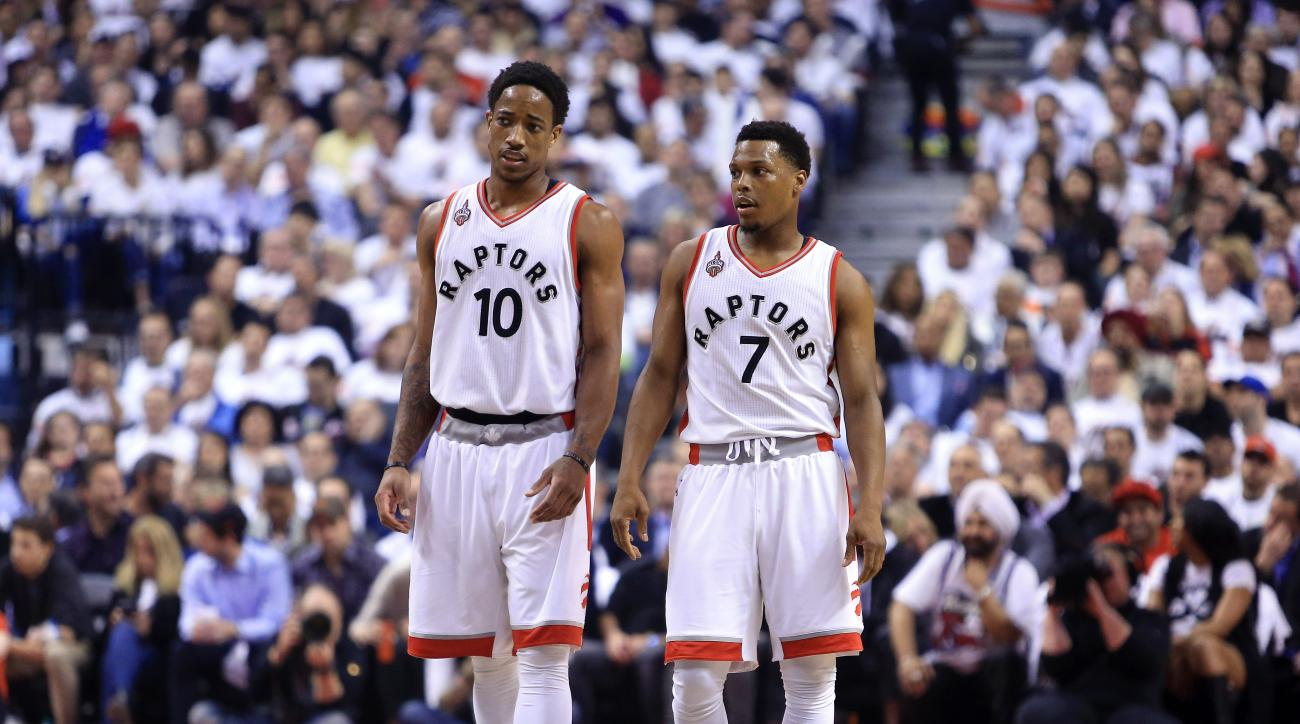 TORONTO, ON - MAY 11:  DeMar DeRozan #10 and Kyle Lowry #7 of the Toronto Raptors talk in the first half of Game Five of the Eastern Conference Semifinals against the Miami Heat during the 2016 NBA Playoffs at the Air Canada Centre on May 11, 2016 in Toro
