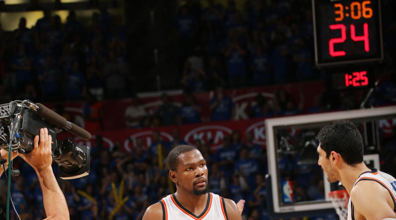 OKLAHOMA CITY, OK - MAY 12: Kevin Durant #35 of the Oklahoma City Thunder celebrates against the San Antonio Spurs in Game Six of Western Conference Quarterfinals of the 2016 NBA Playoffs on May 12, 2016 Chesapeake Energy Arena in Oklahoma City, Oklahoma.