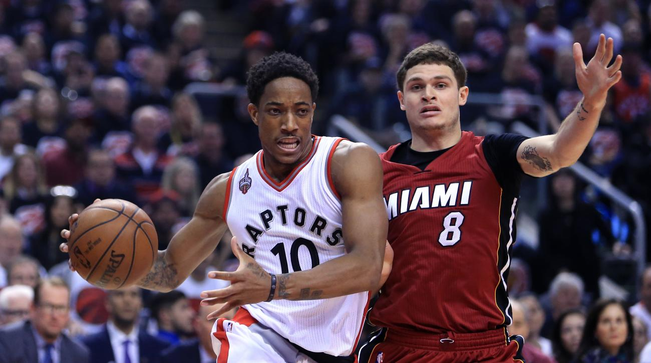 TORONTO, ON - MAY 15:  DeMar DeRozan #10 of the Toronto Raptors dribbles the ball as Tyler Johnson #8 of the Miami Heat defends in Game Seven of the Eastern Conference Quarterfinals during the 2016 NBA Playoffs at the Air Canada Centre on May 15, 2016 in