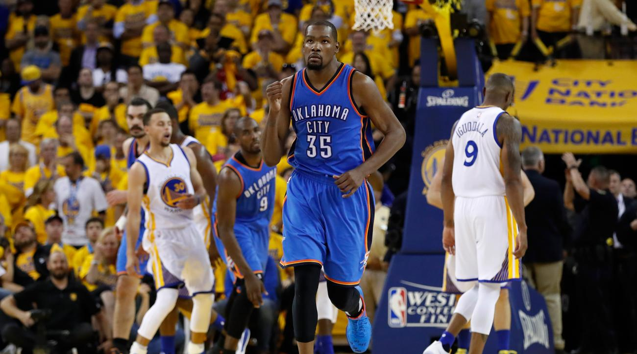 OAKLAND, CA - MAY 16:  Kevin Durant #35 of the Oklahoma City Thunder reacts after a basket in the fourth quarter against the Golden State Warriors during game one of the NBA Western Conference Final at ORACLE Arena on May 16, 2016 in Oakland, California.