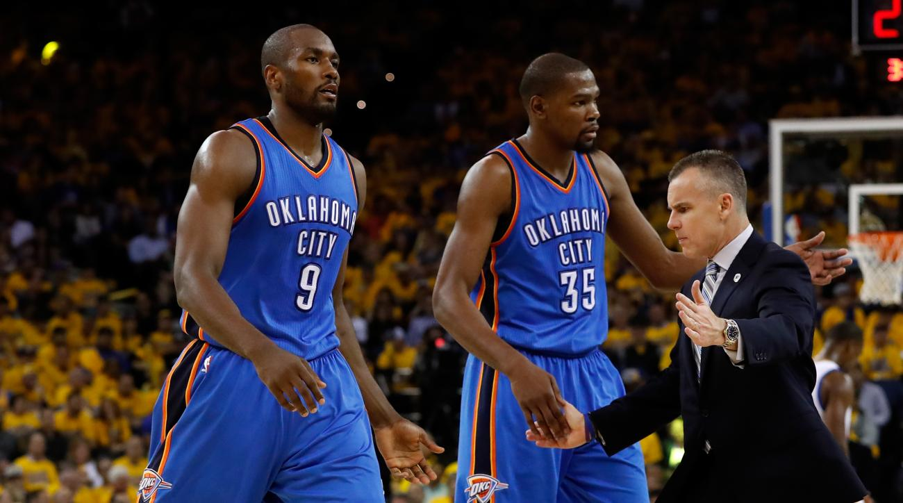 OAKLAND, CA - MAY 16:  Billy Donovan of the Oklahoma City Thunder high fives Serge Ibaka #9 and Kevin Durant #35 during game one of the NBA Western Conference Finals against the Golden State Warriors at ORACLE Arena on May 16, 2016 in Oakland, California.