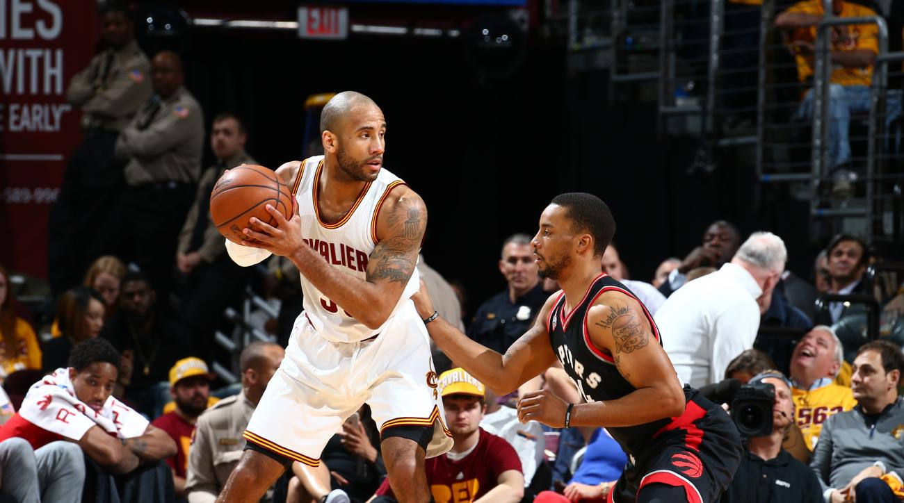 CLEVELAND, OH - MAY 17: Dahntay Jones #30 of the Cleveland Cavaliers handles the ball against the Toronto Raptors in Game One of the Eastern Conference Finals during the 2016 NBA Playoffs on May 17, 2016 at Quicken Loans Arena in Cleveland, Ohio.  (Photo