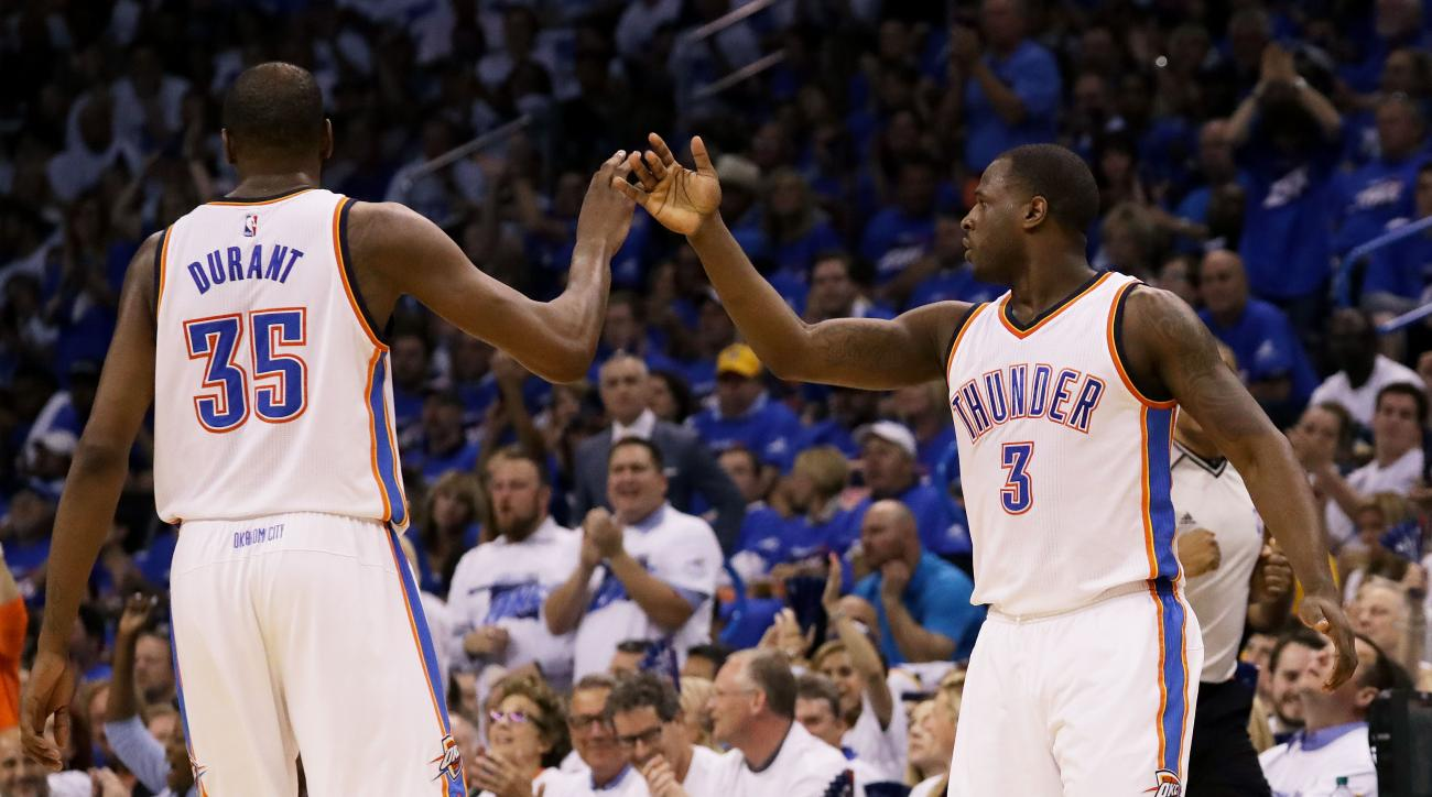OKLAHOMA CITY, OK - MAY 22:  Kevin Durant #35 and Dion Waiters #3 of the Oklahoma City Thunder celebrate in the second quarter against the Golden State Warriors and in game three of the Western Conference Finals during the 2016 NBA Playoffs at Chesapeake