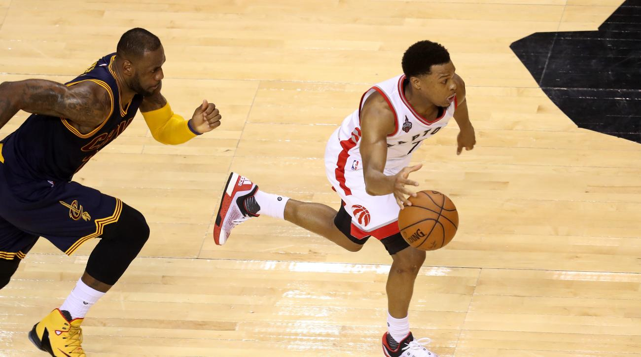 TORONTO, ON - MAY 23: Kyle Lowry #7 of the Toronto Raptors handles the ball in the fourth quarter against LeBron James #23 of the Cleveland Cavaliers in game four of the Eastern Conference Finals during the 2016 NBA Playoffs at the Air Canada Centre on Ma