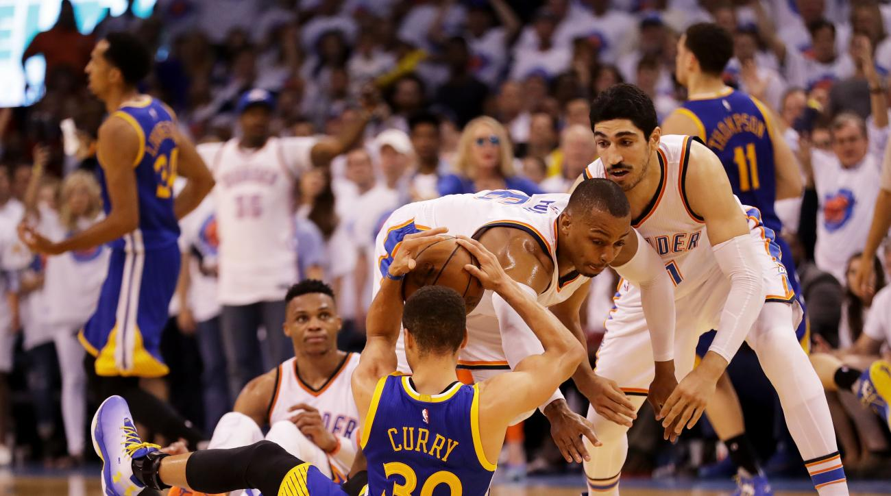 OKLAHOMA CITY, OK - MAY 24:  Stephen Curry #30 of the Golden State Warriors controls the ball against Dion Waiters #3 of the Oklahoma City Thunder in the third quarter in game four of the Western Conference Finals during the 2016 NBA Playoffs at Chesapeak