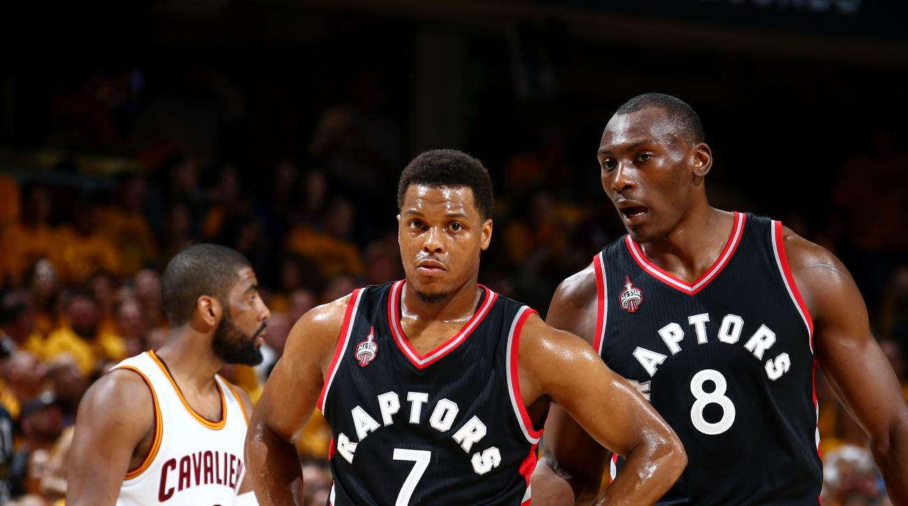 CLEVELAND, OH - MAY 25:  Kyle Lowry #7 of the Toronto Raptors and Bismack Biyombo #8 of the Toronto Raptors talk during the game against the Cleveland Cavaliers in Game Five of the Eastern Conference Finals during the 2016 NBA Playoffs on May 25, 2016 at