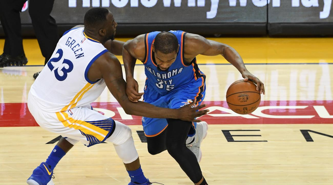 OAKLAND, CA - MAY 26:  Draymond Green #23 of the Golden State Warriors defends Kevin Durant #35 of the Oklahoma City Thunder during Game Five of the Western Conference Finals during the 2016 NBA Playoffs at ORACLE Arena on May 26, 2016 in Oakland, Califor