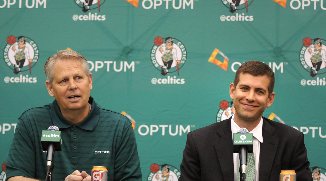 WALTHAM, MA - JULY 5: New Boston Celtics head coach Brad Stevens (R) is introduced to the media by President of Basketball Operations Danny Ainge July 5, 2013 in Waltham, Massachusetts. Stevens was hired away from Butler University where he led the Bulldo